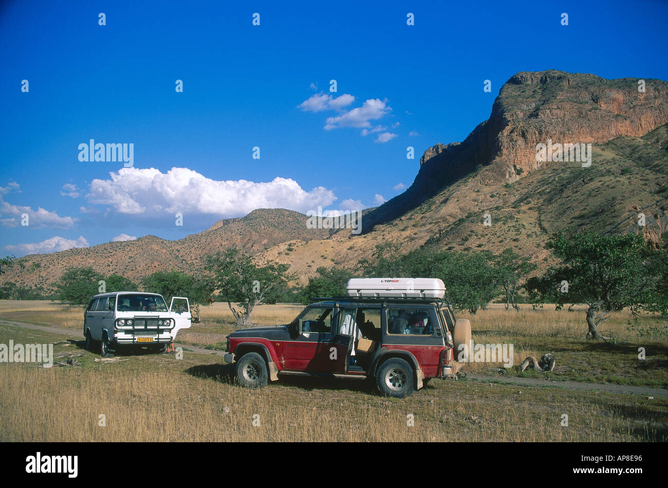 Two SUVs on a landscape - Stock Image