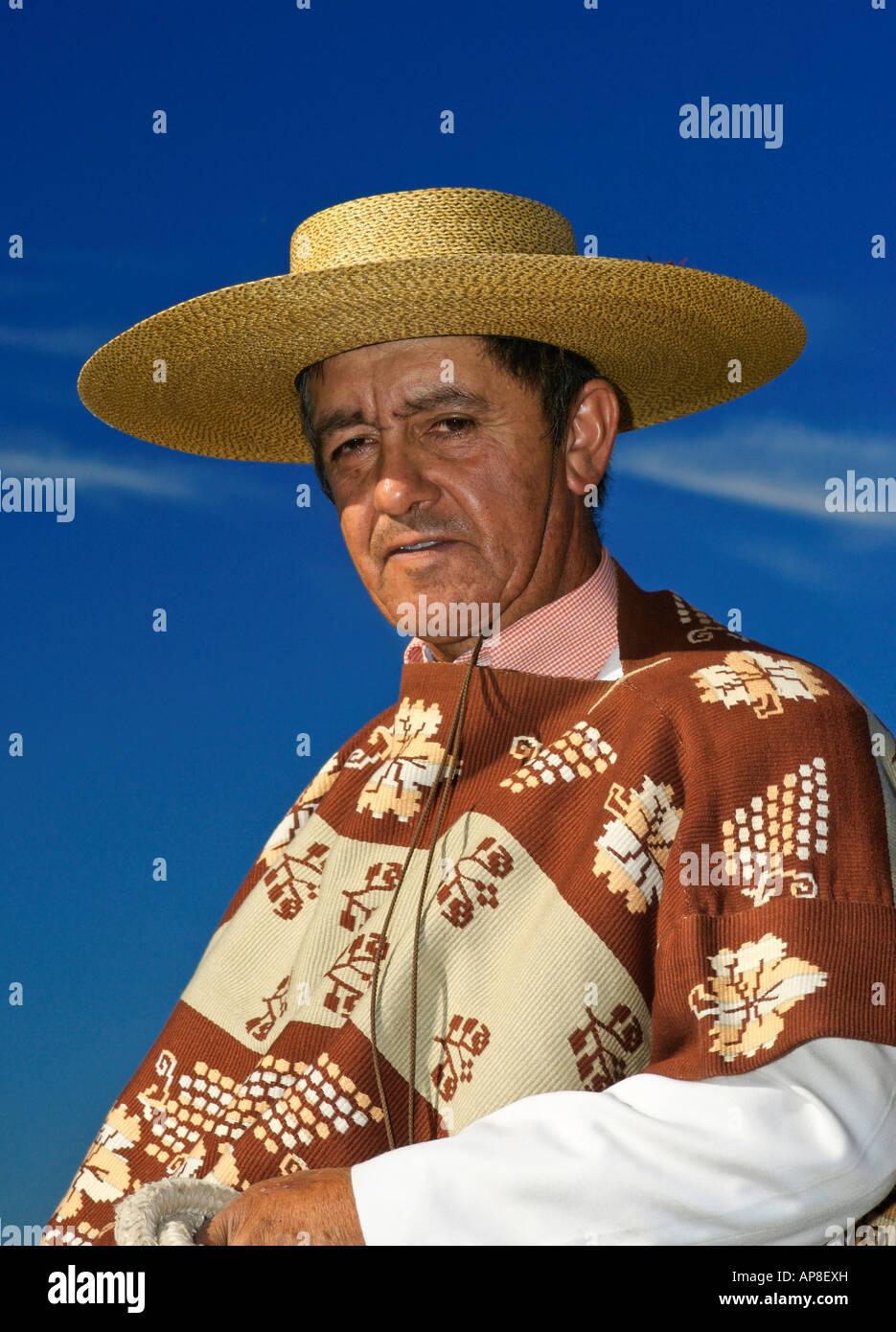 Huaso wearing traditional chupalla straw hat and poncho Chile Rapel - Stock Image