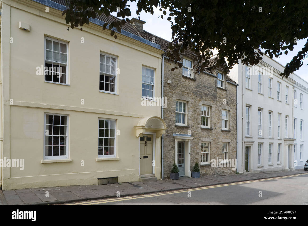 Eighteenth century houses in Chipping Street in the Cotswold town of Tetbury, Gloucestershire - Stock Image