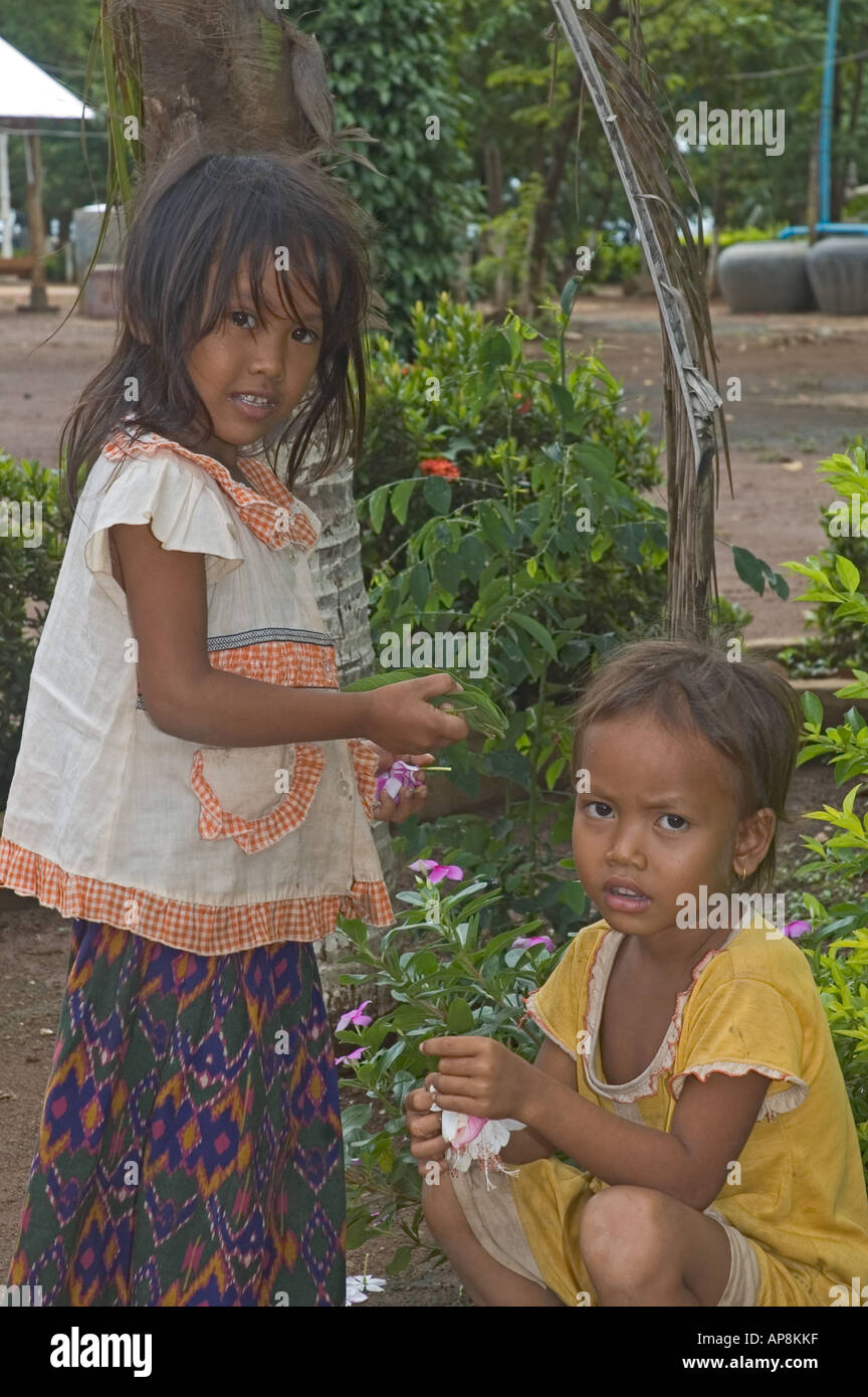 Cambodia Kampong Cham Wat Hanchey Buddhist Temple young girls in garden Stock Photo