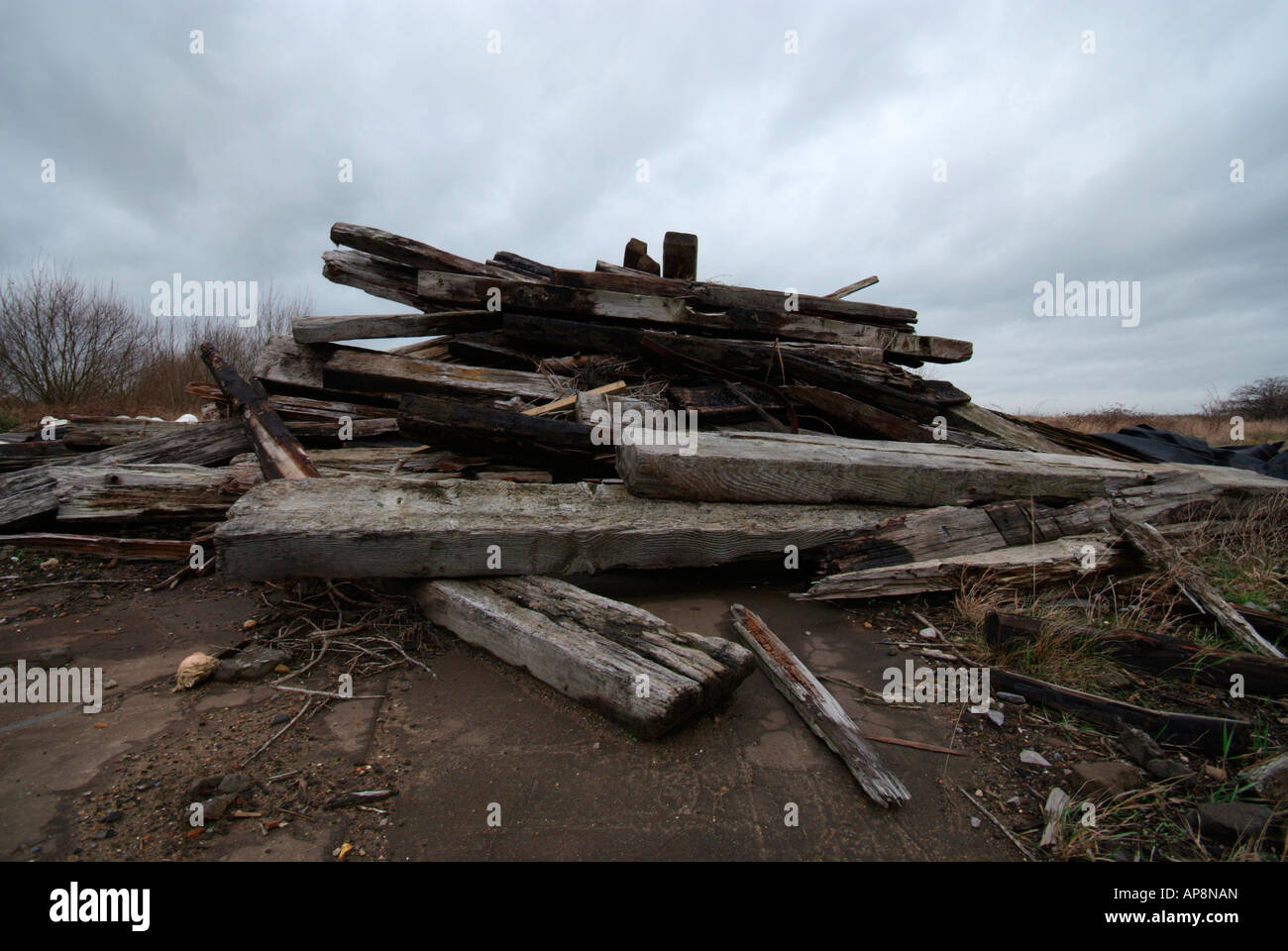 Railway sleepers dumped onto the ground - Stock Image