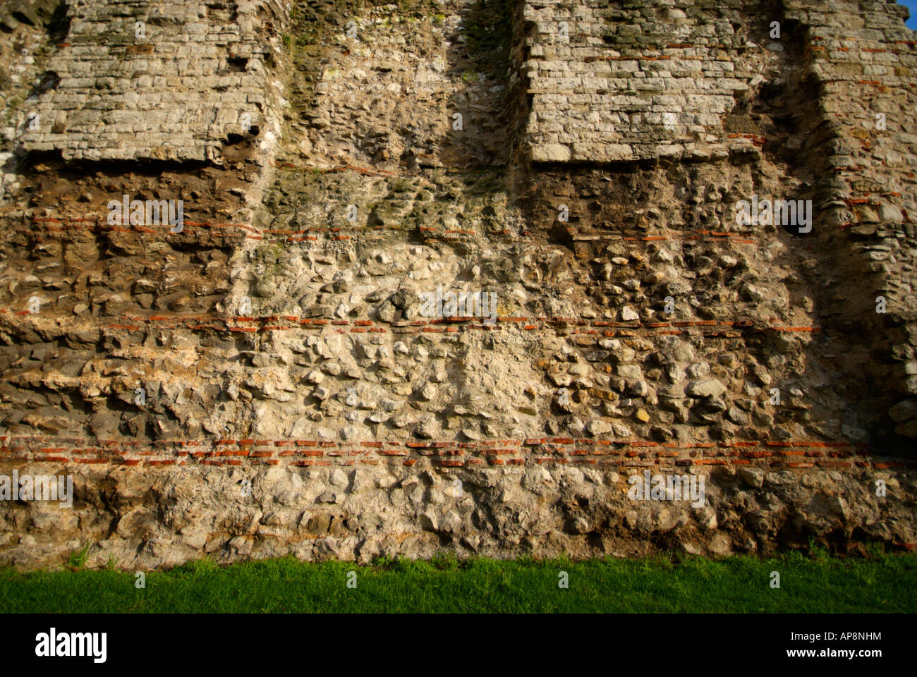 The last remaining section of the Roman wall at Tower Hill, London. - Stock Image