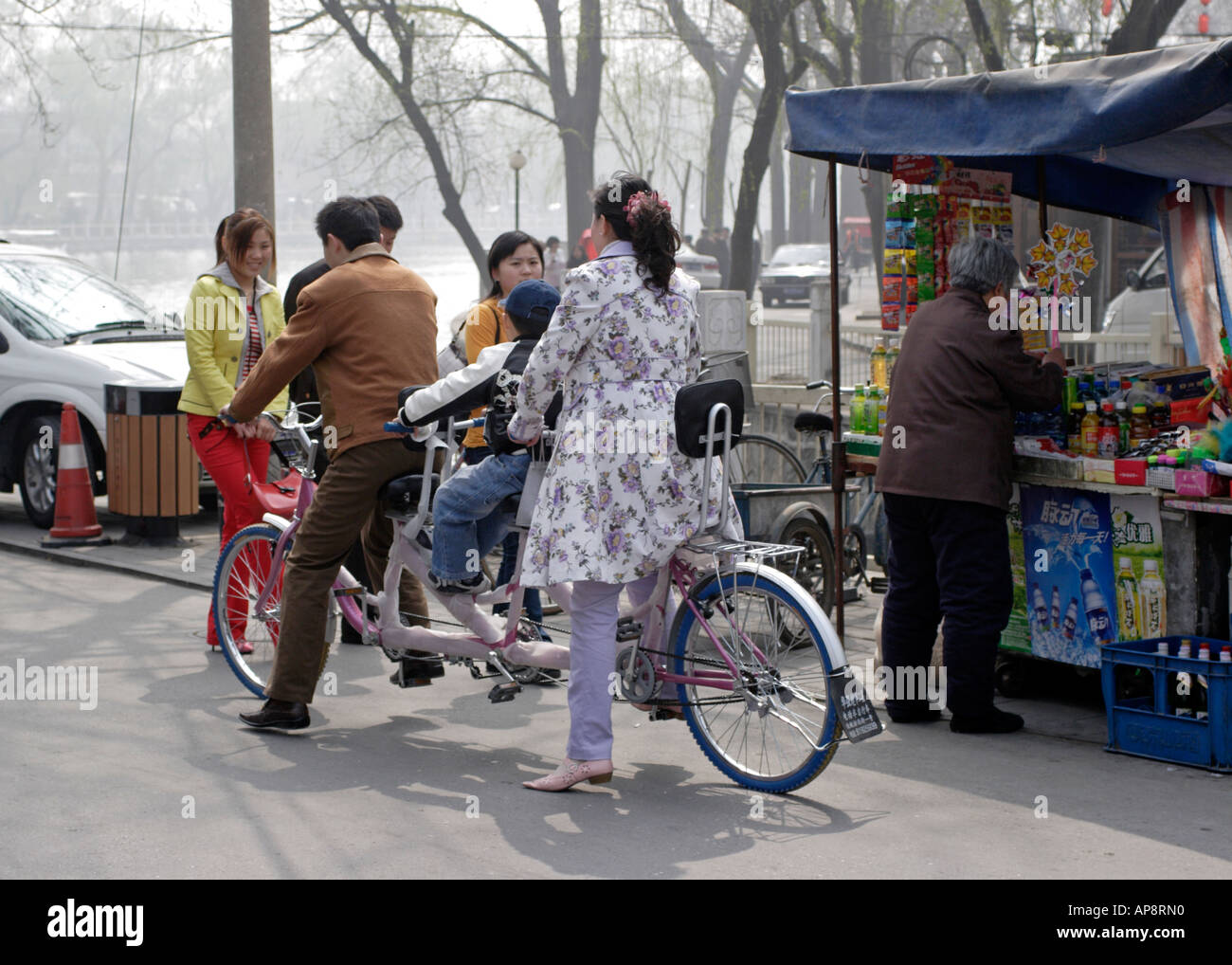Three seater Bicycle in Beijing China - Stock Image