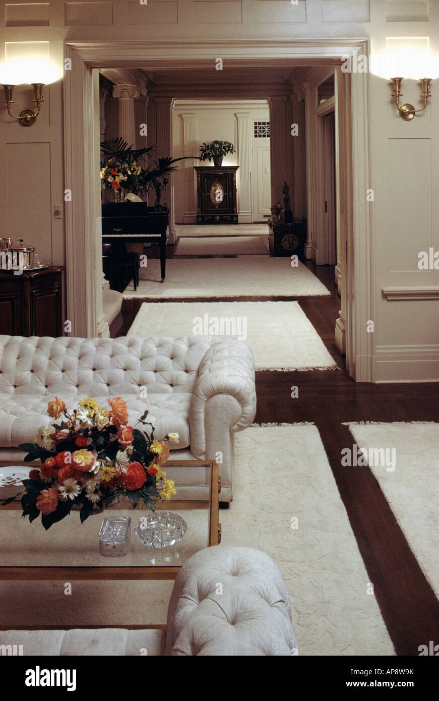 Cream Chesterfield Sofa And Cream Rugs In Neutral Sixties Living