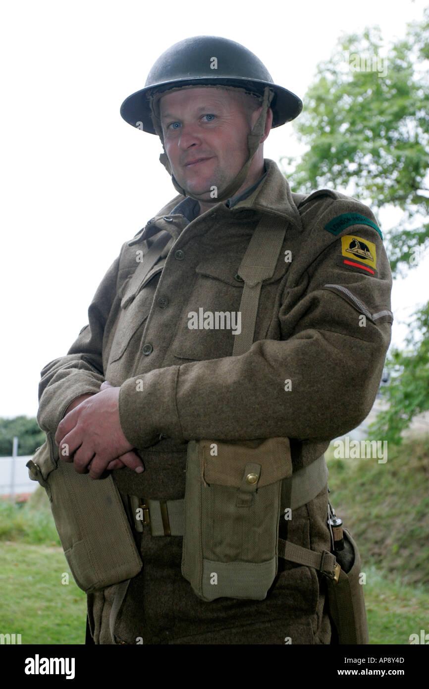reinactor in dress of london irish rifles world war 2 WW2 uniform at Grey Point Fort Helens Bay County Down Northern Ireland - Stock Image