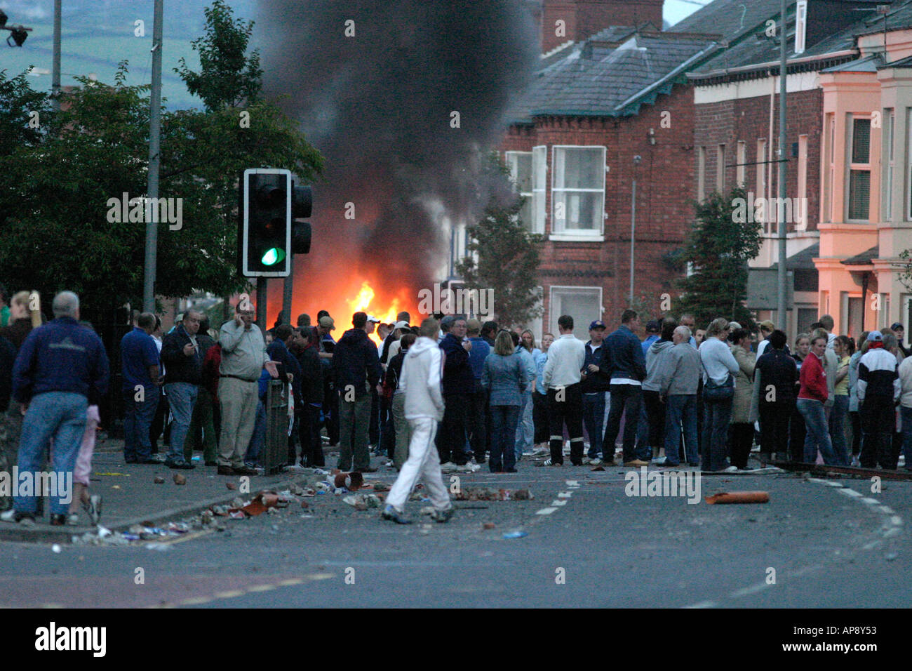 loyalist protestors block the road in front of burning vehicle on the Albertbridge Road Belfast Northern Ireland - Stock Image