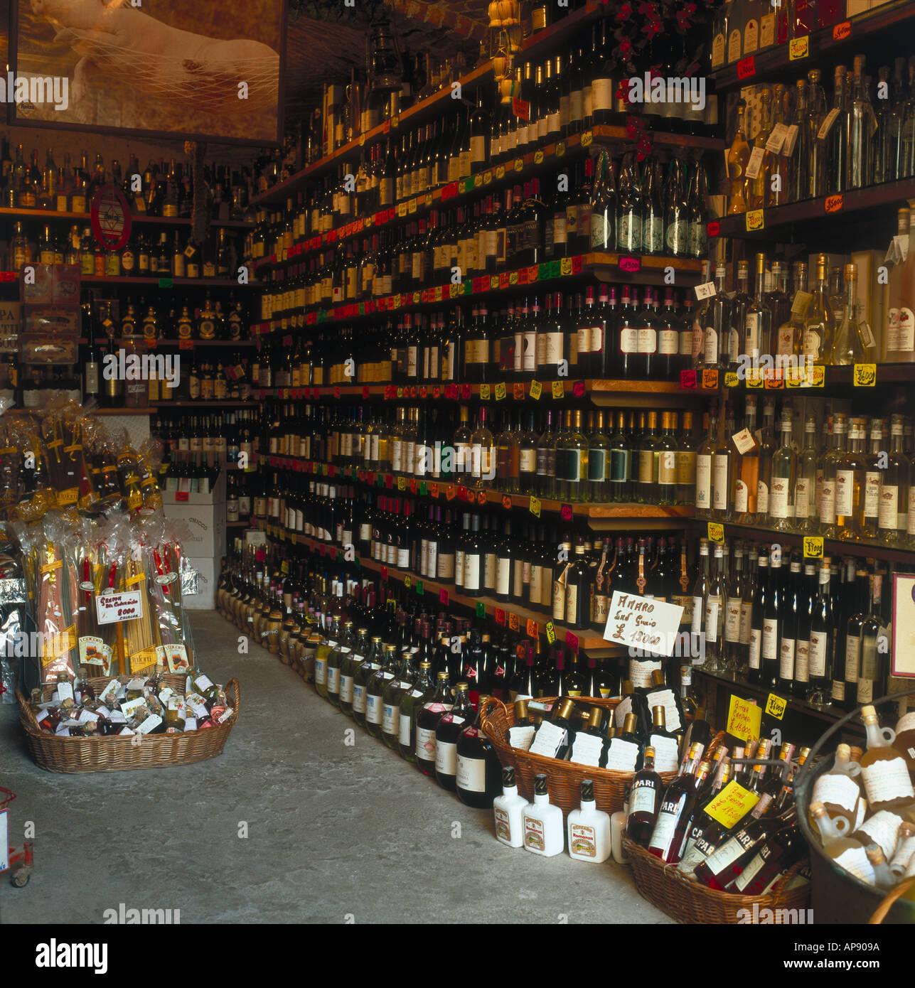 Wine bottles inside shop, Piedmont, Italy Stock Photo