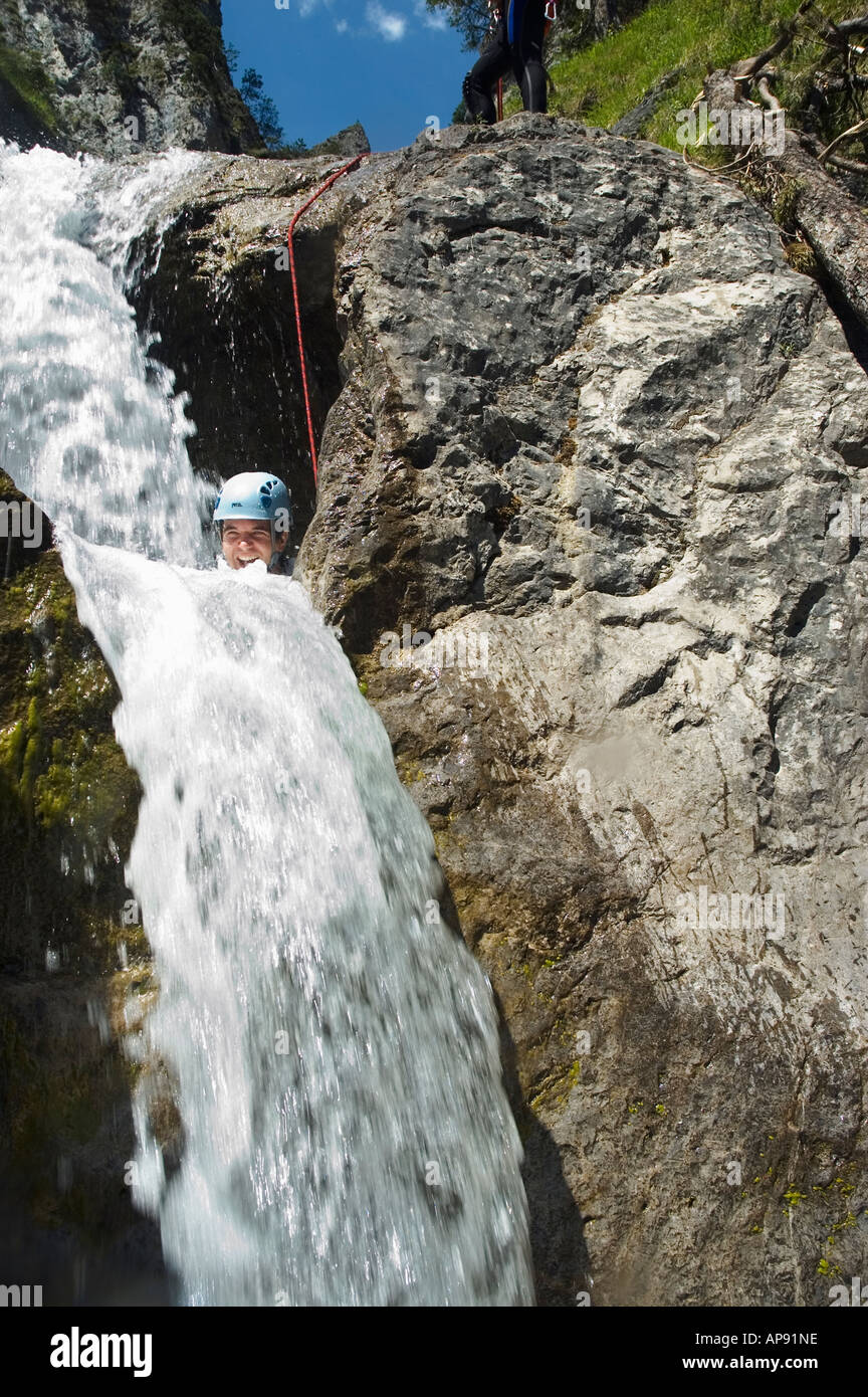 Getting a ducking on a canyoning trip in the Lechtal in the Austrian Tirol - Stock Image
