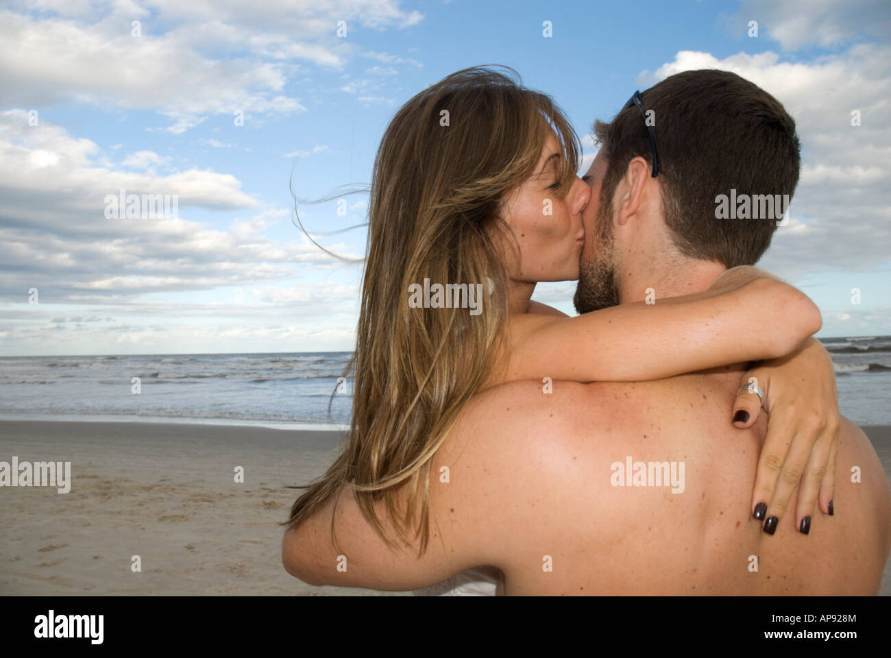 a boy naked and a girl naked kissing