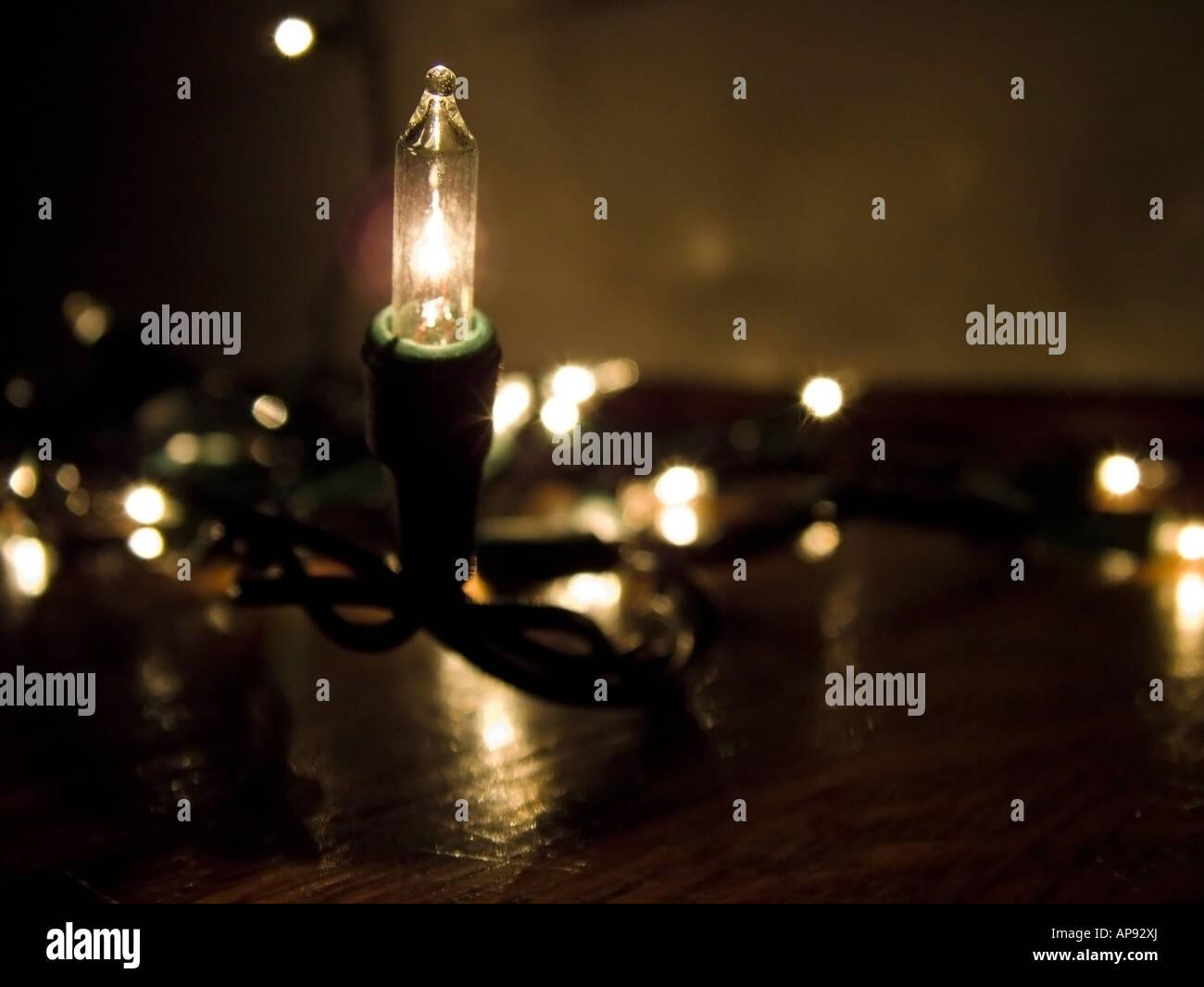 White String Christmas Lights.String Of White Christmas Lights On A Wood Floor Stock Photo