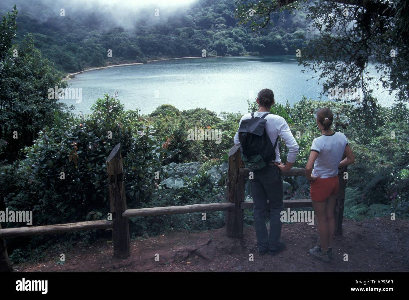 Young couple looking at Laguna Botos in the Parque Nacional Volcan Poas, Costa Rica - Stock Image