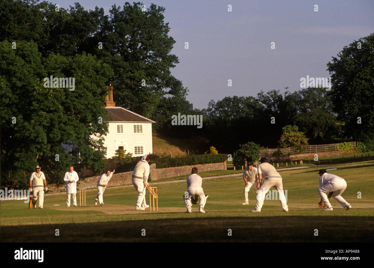 Village cricket game at Tilford Surrey. England HOMER SYKES Stock Photo