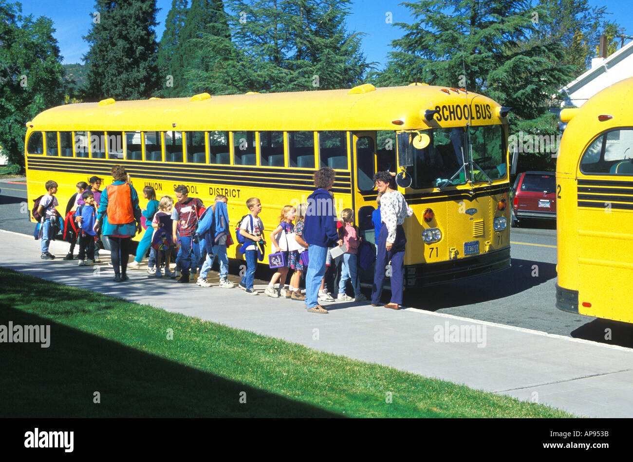 Elementary School Children Boarding School Bus After School Mt