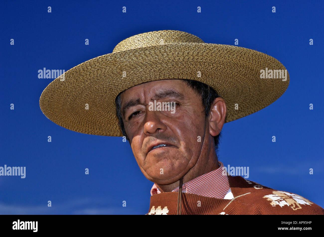 Huaso wearing traditional chupalla straw hat Chile Rapel - Stock Image
