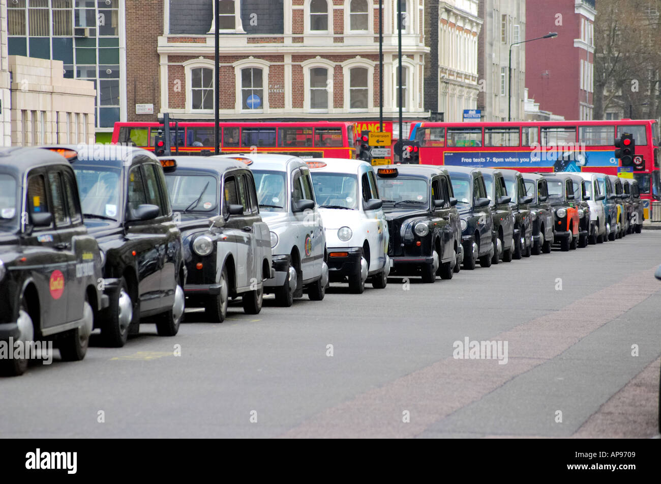 London licensed taxi black cabs taxis - Stock Image