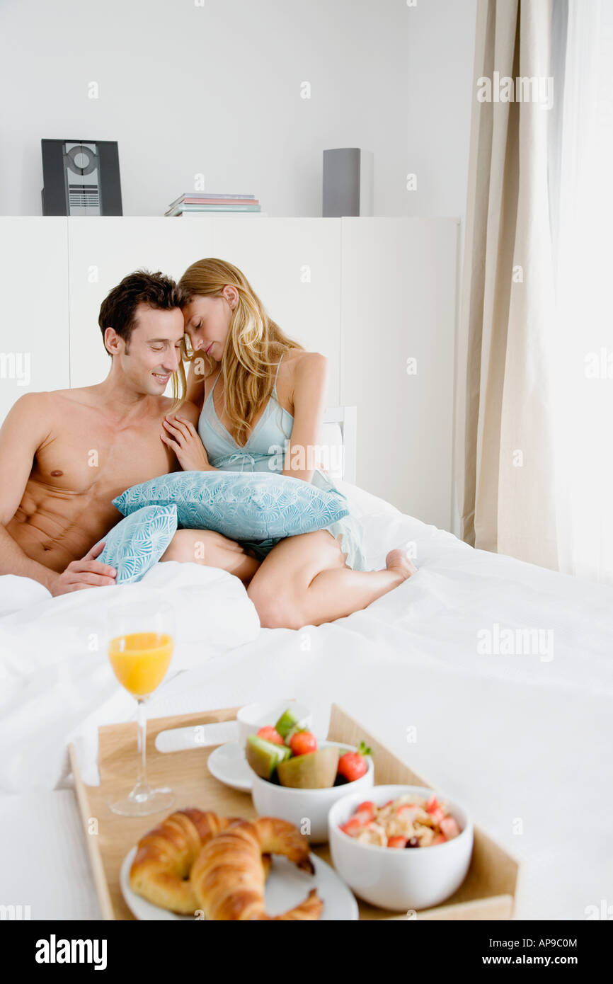 Intimate couple with breakfast in bed - Stock Image