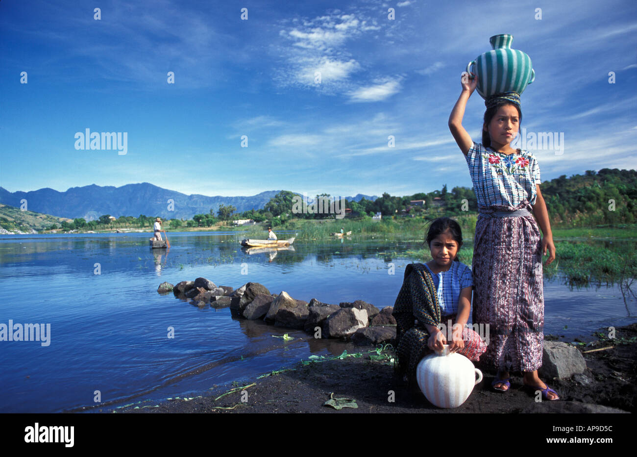 Tzutujil Maya girls from Santiago Atitlan collecting water from Lake Atitlan morning Guatemala - Stock Image