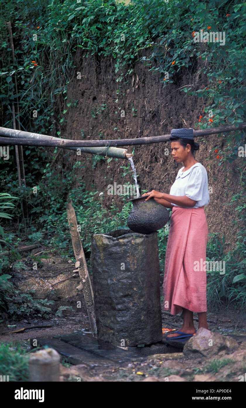 Woman collecting water from a rural standpipe Shan state Burma - Stock Image
