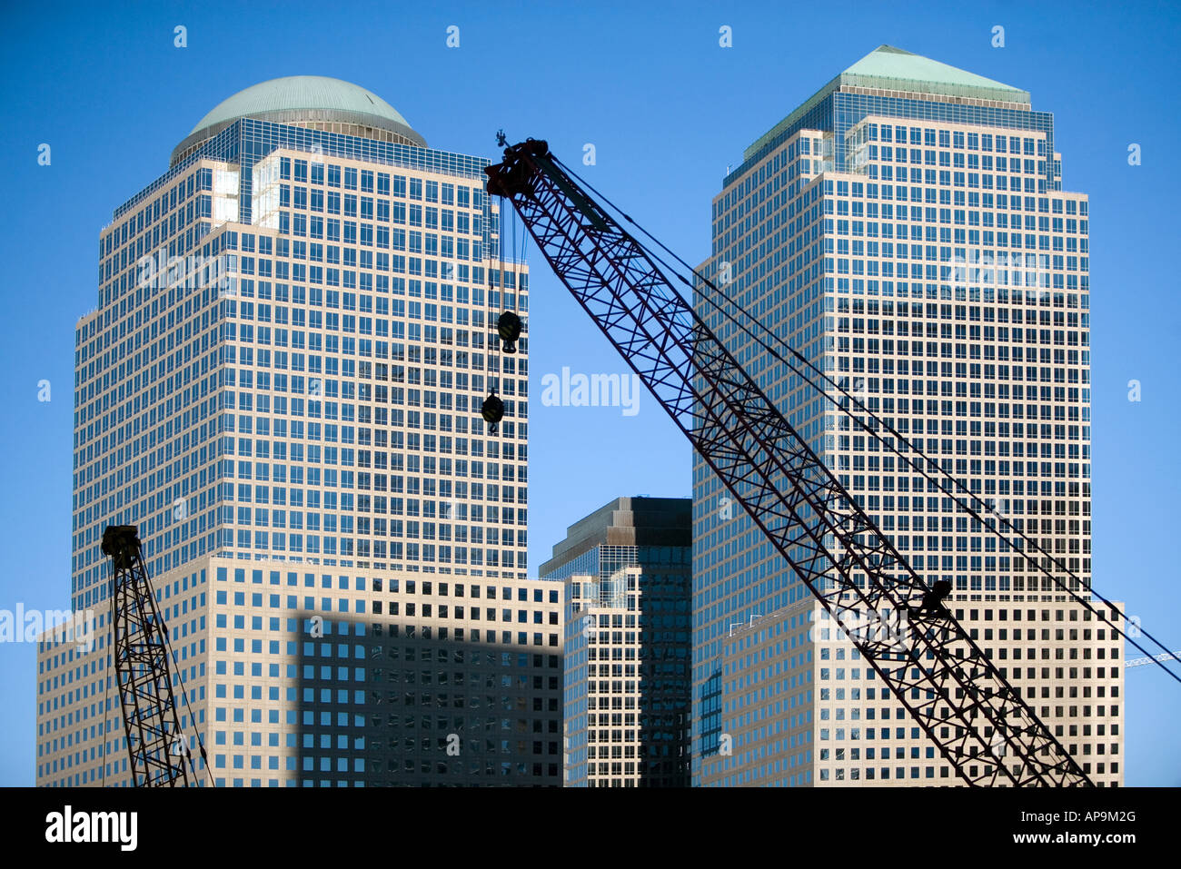 Cranes and world financial center - Stock Image