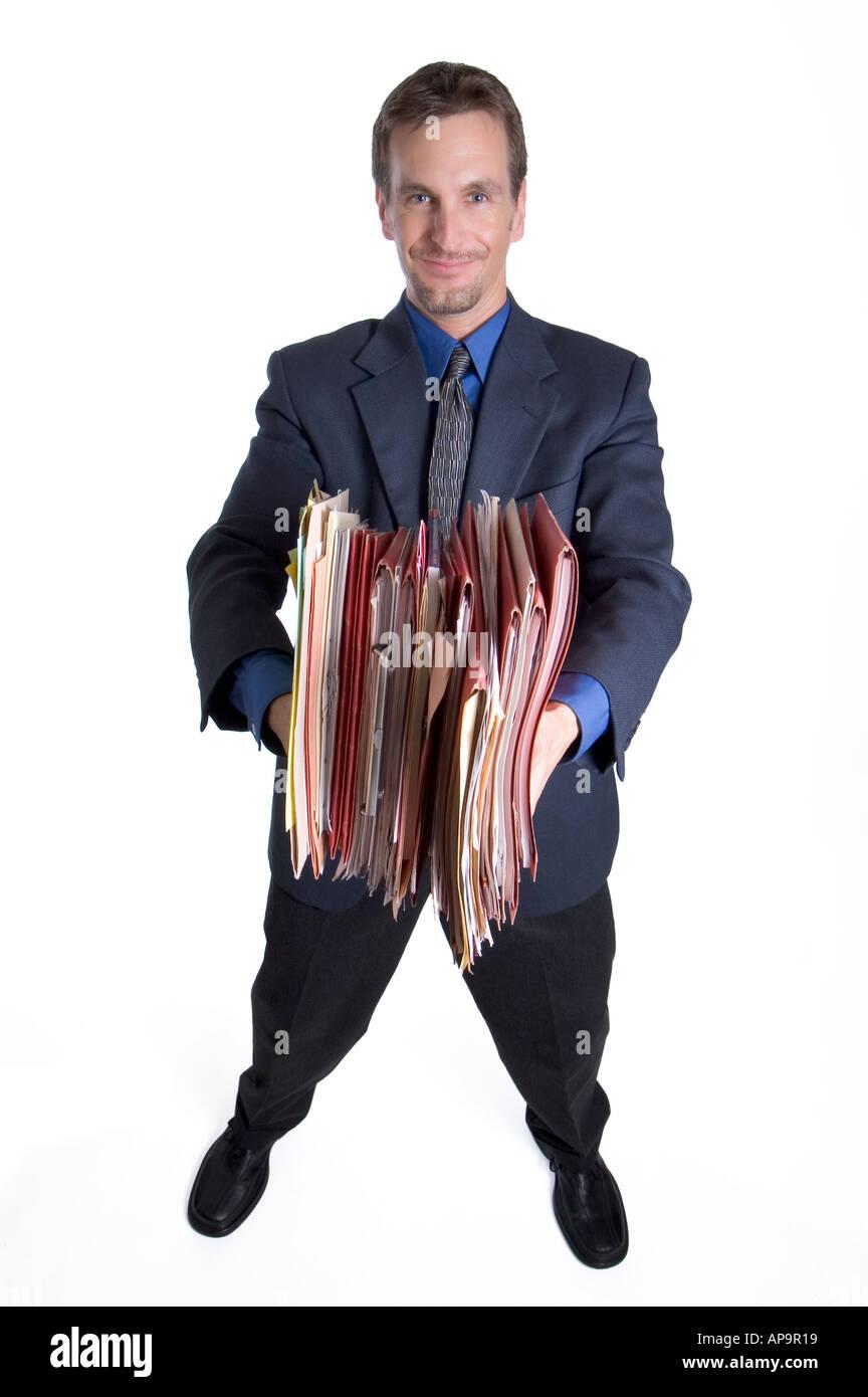 Businessman offering folders - Stock Image