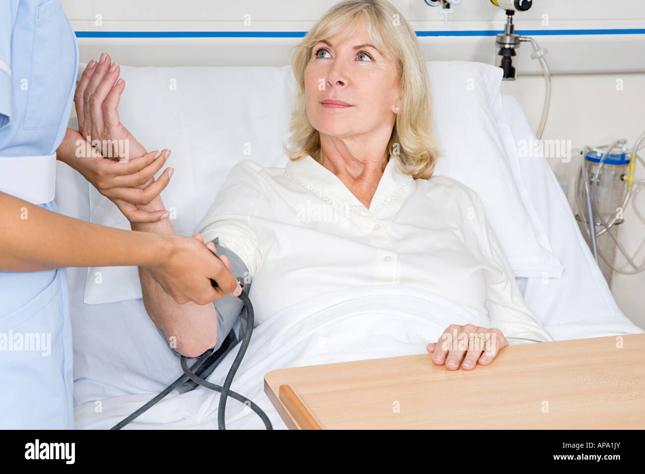 Woman having her blood pressure taken - Stock Image
