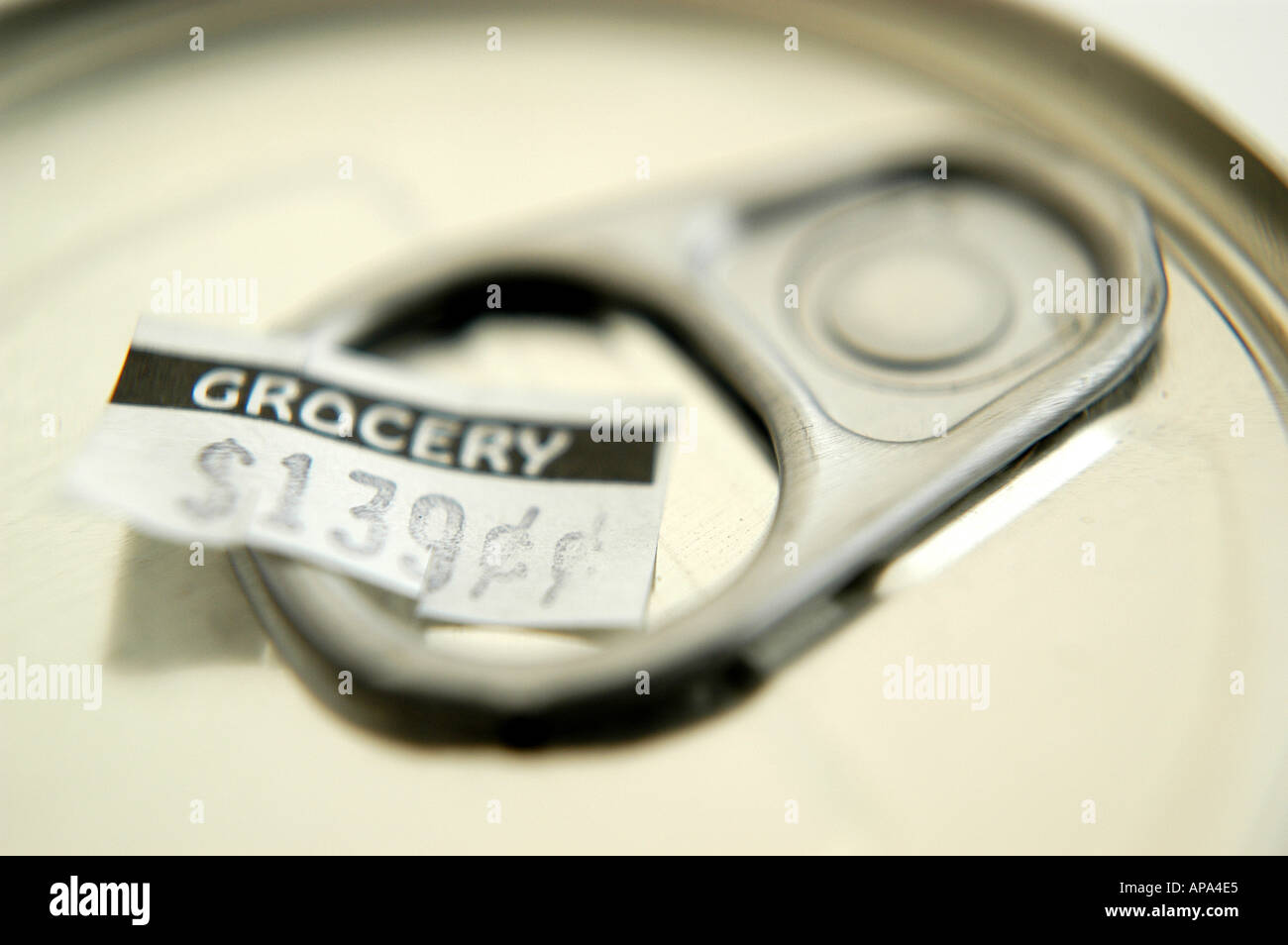 Close up aluminum can pull tab with GROCERY price tag HORIZONTAL - Stock Image