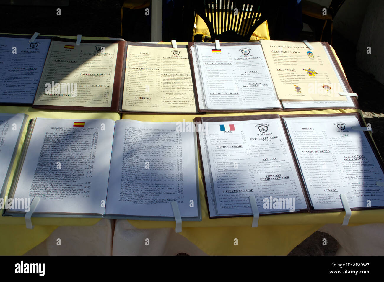 Menus in many languages outside a restaurant in Mijas, Spain - Stock Image