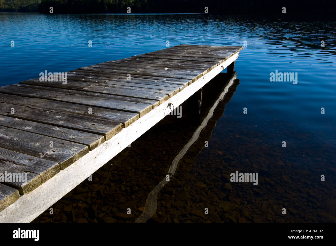 Cottage dock on Kelly Creek Mataquac Headpond St John River Valley New Brunswick Canada - Stock Image