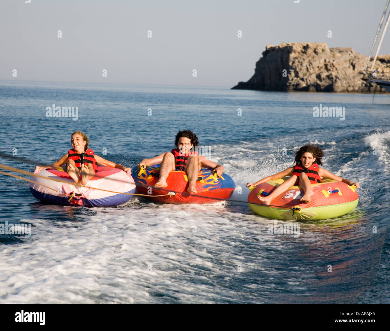 Children On Ringos Lindos Rhodes Greek Islands Greece Hellas - Stock Image