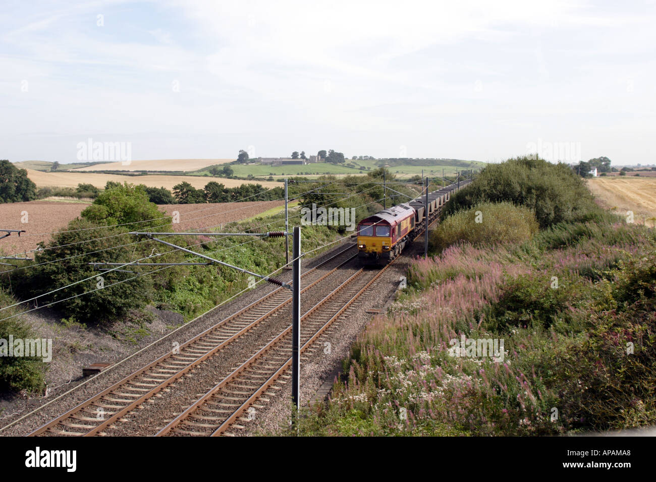 Empty Coal Train on the East Coast Main Line in Northumberland - Stock Image