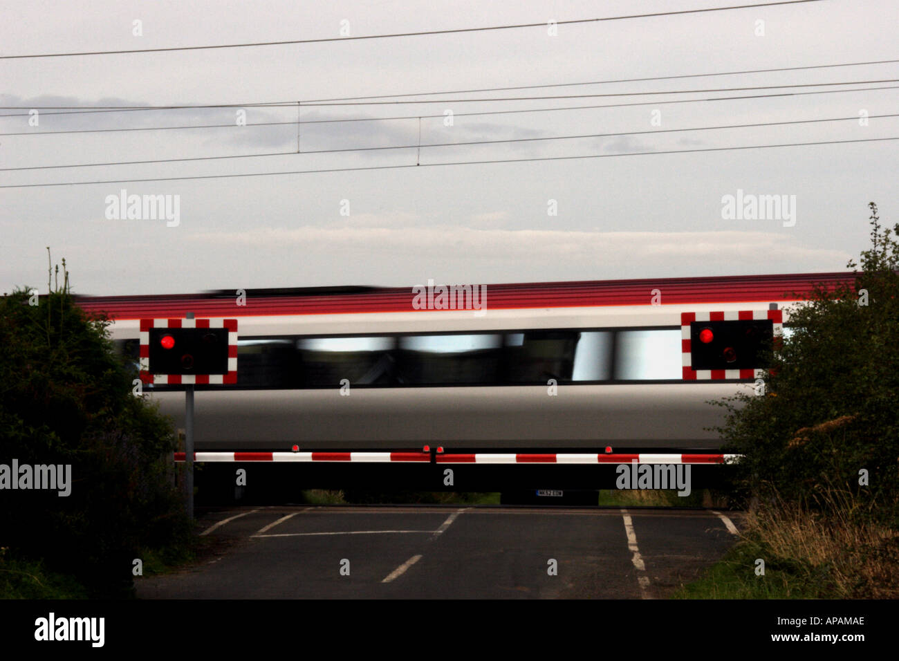 Inter-City Train Crosses a level crossing on the East Coast Main Line in Northumberland - Stock Image