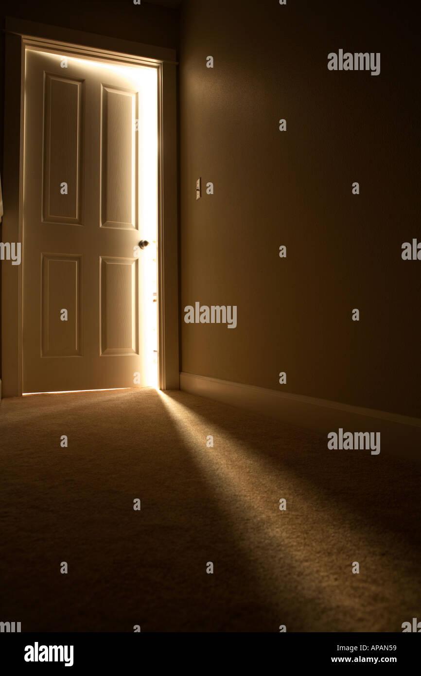 Light coming from door - Stock Image
