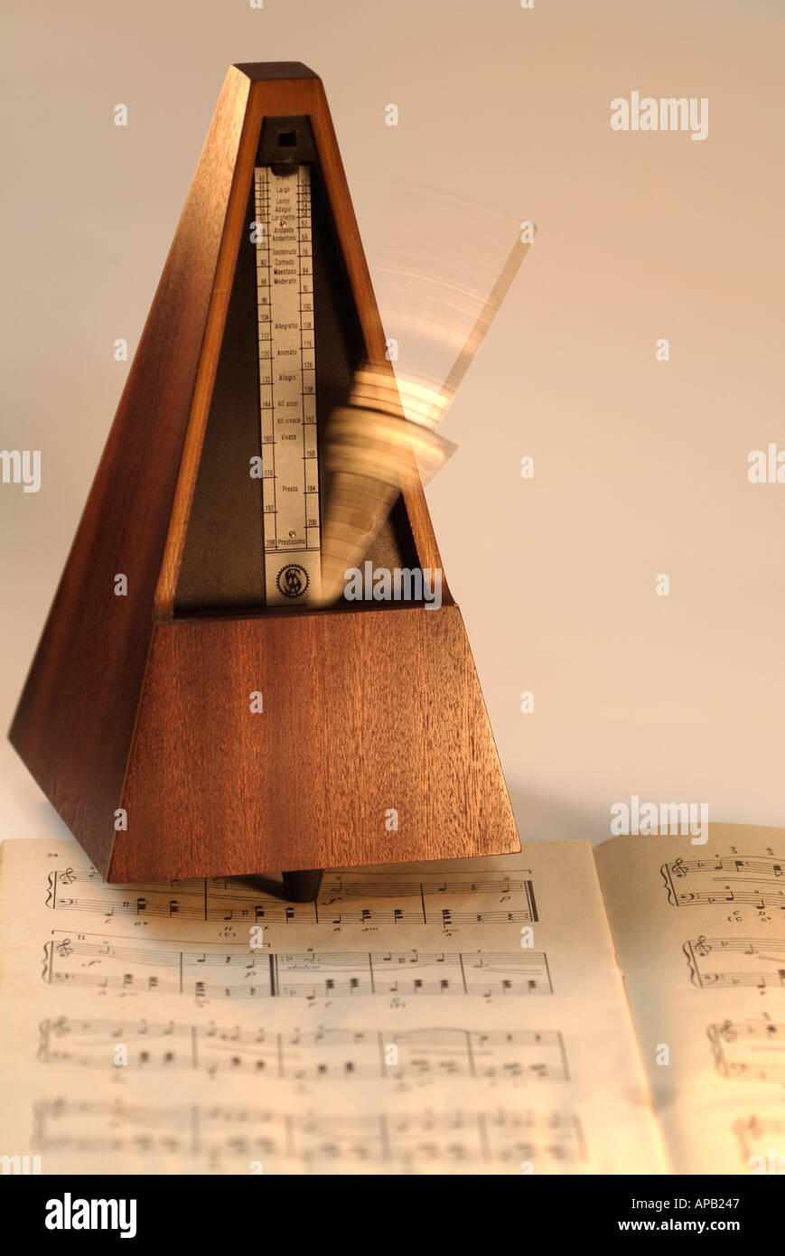 Metronome on a Music Book - Stock Image