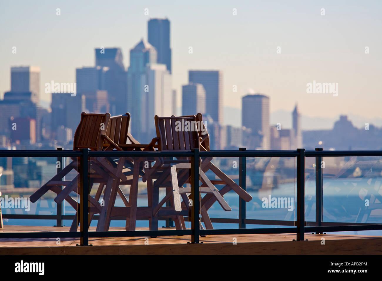 teak deck chairs lean against table on deck overlooking elliott bay