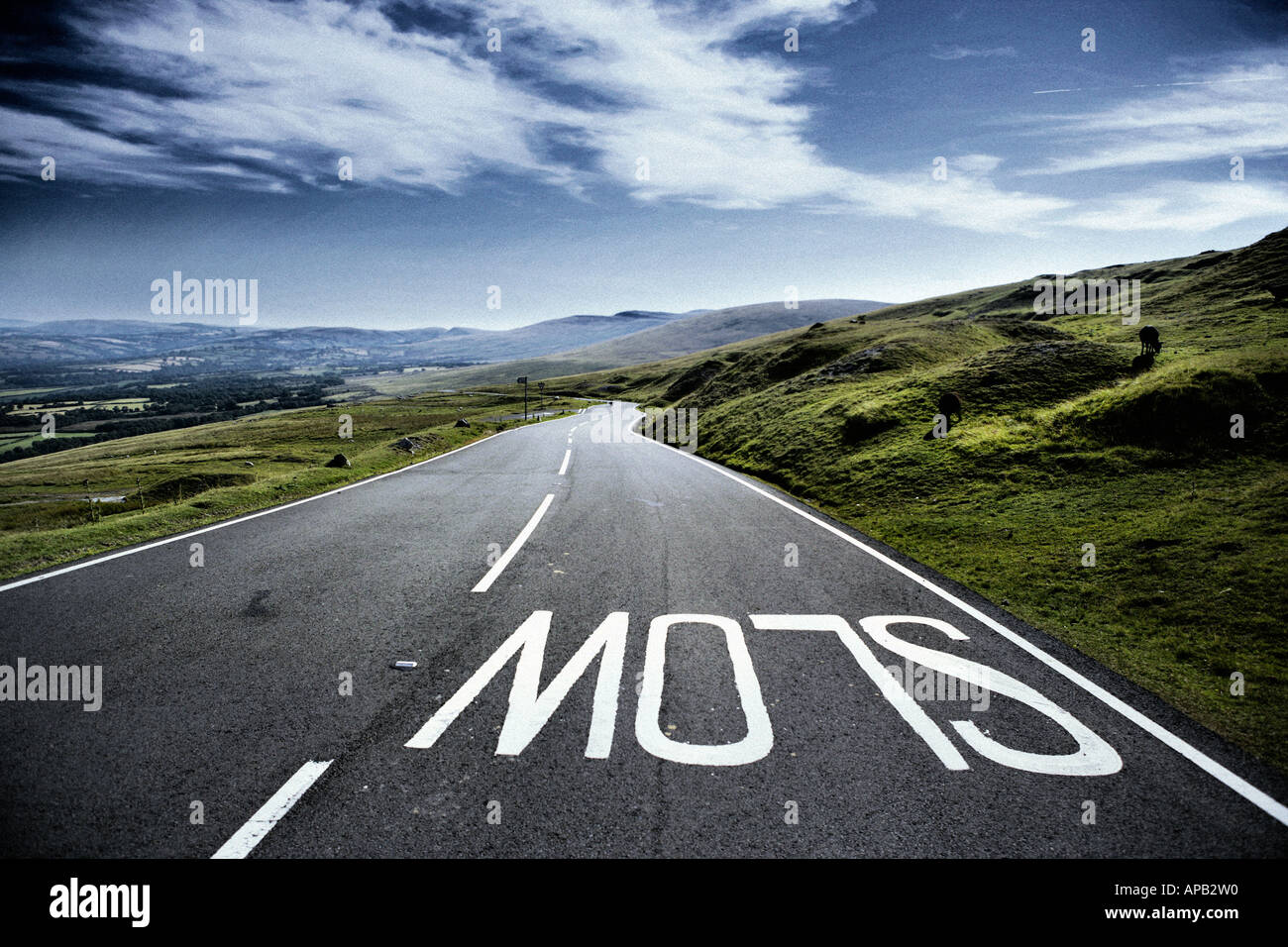 A countryside road depicting the slow instruction - Stock Image