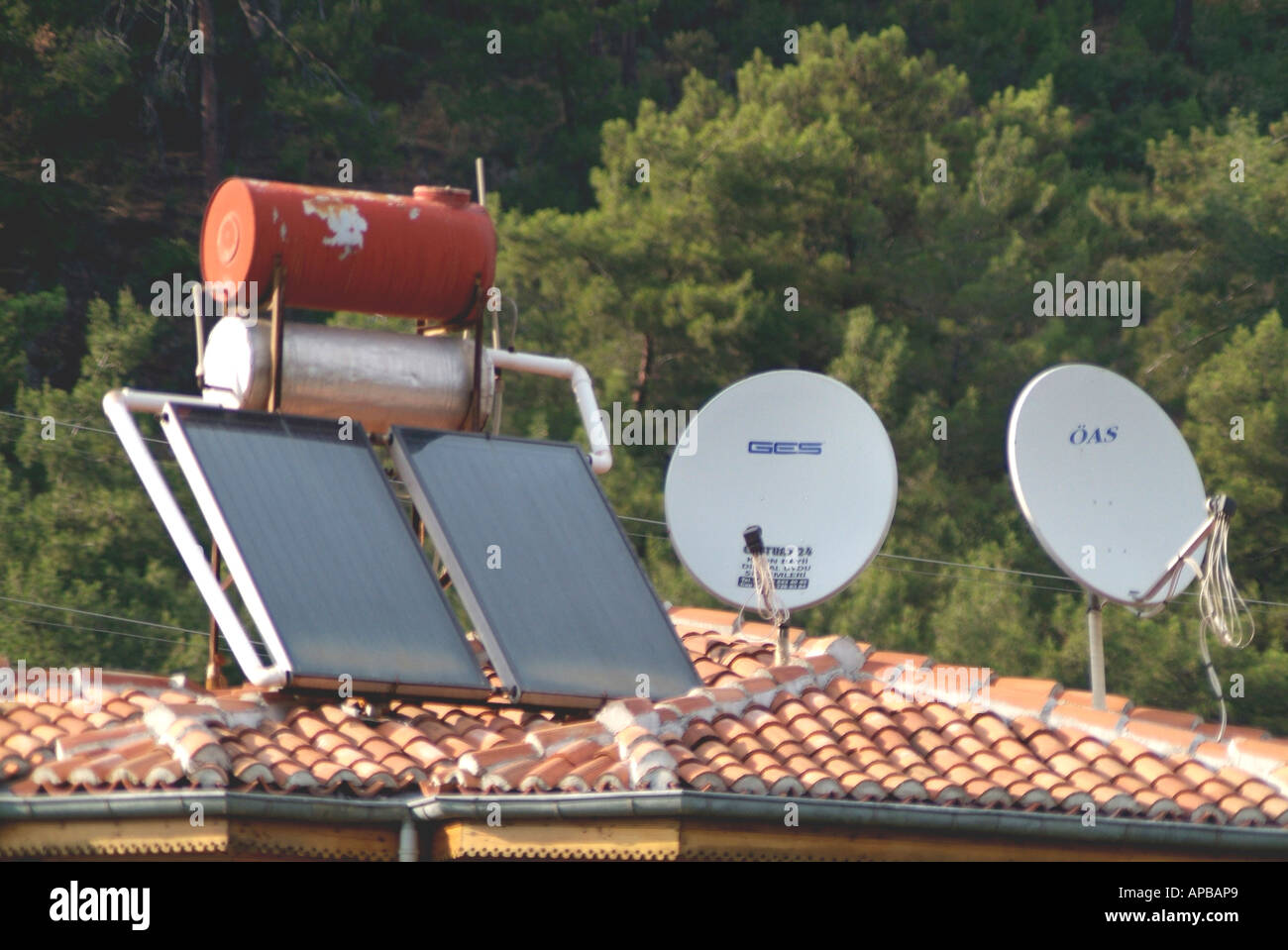 solar water heating panels on roof - Stock Image