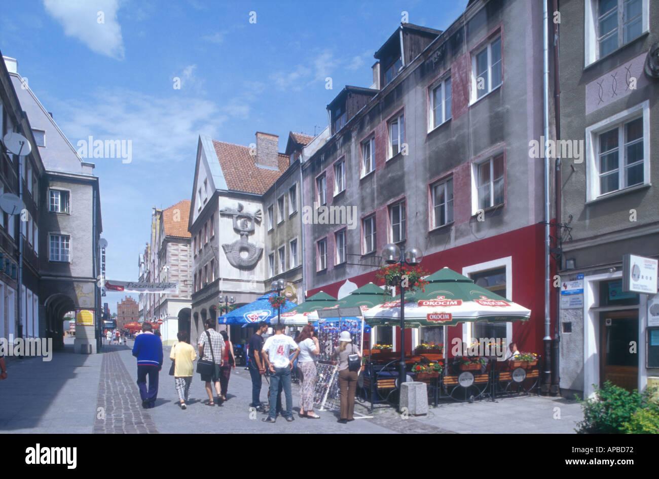 people on th lane old town centre Olsztyn Mazuria Poland  - Stock Image