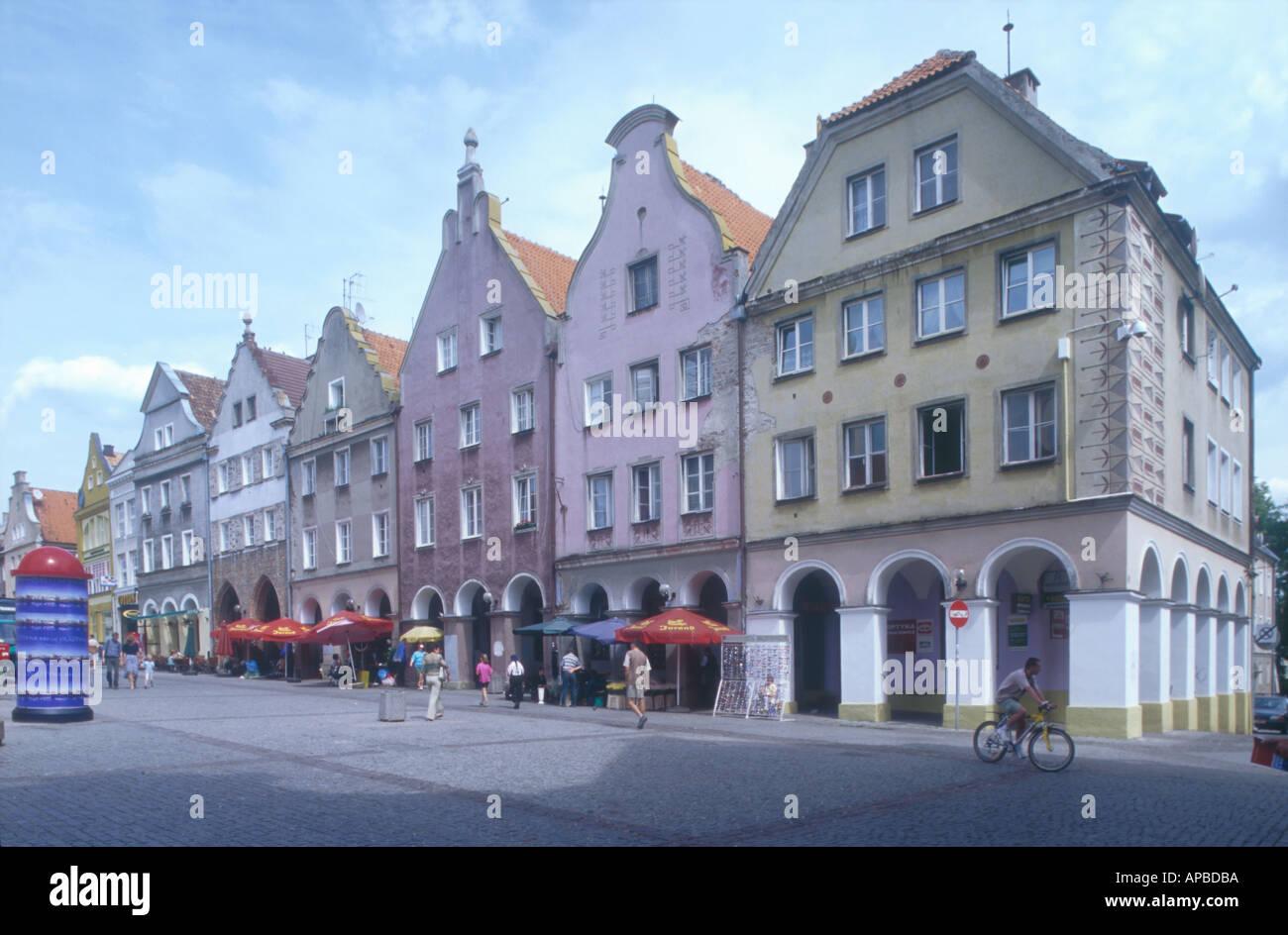row of medieval house facades old town centre market square Olsztyn Mazuria Poland  - Stock Image