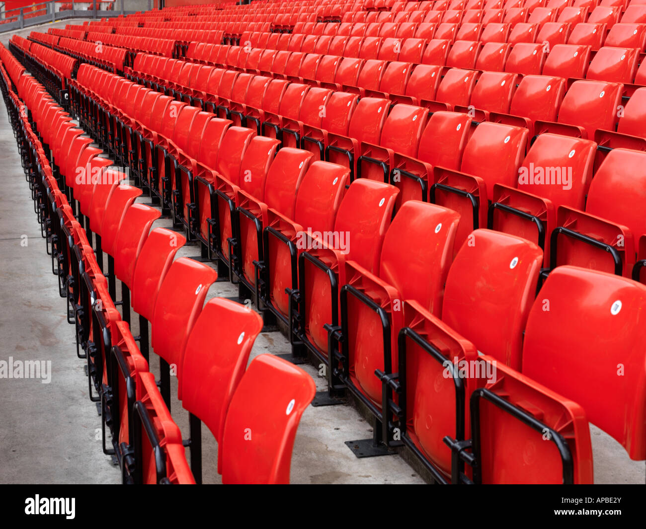 United Kingdom Manchester rows of red stadium seats at Manchester United - Stock Image