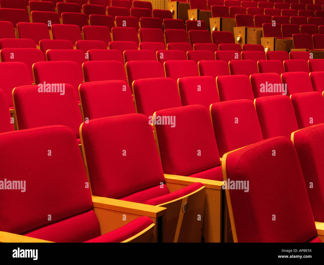 United Kingdom Manchester rows of empty red seats in an auditorium - Stock Image
