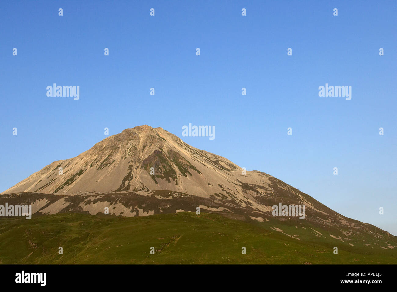 Errigal mountain in evening light donegals highest peak against a blue sky - Stock Image