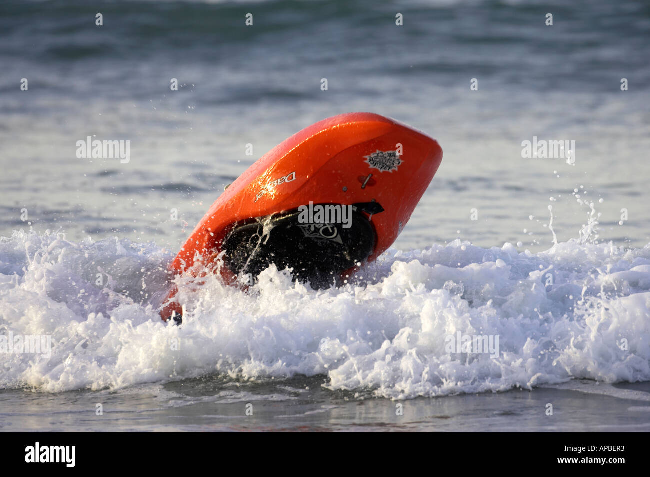 male kayaker capsized over turned in a wave in the sea off white rocks beach portrush county antrim northern ireland - Stock Image