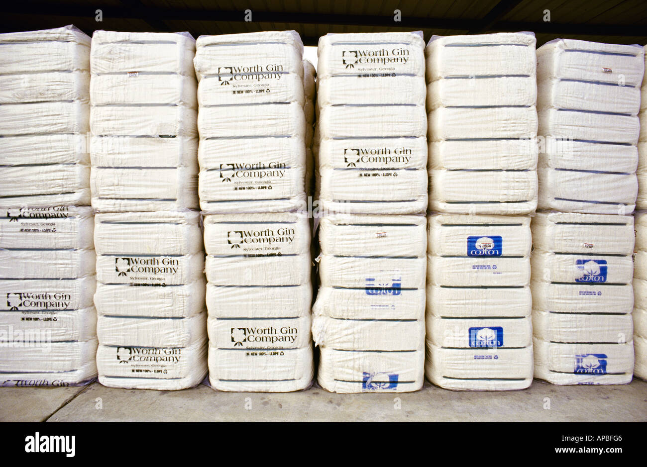 Agriculture - Bales of processed cotton sit on a loading dock at a warehouse awaiting shipping / Sylvester, Georgia, USA. - Stock Image