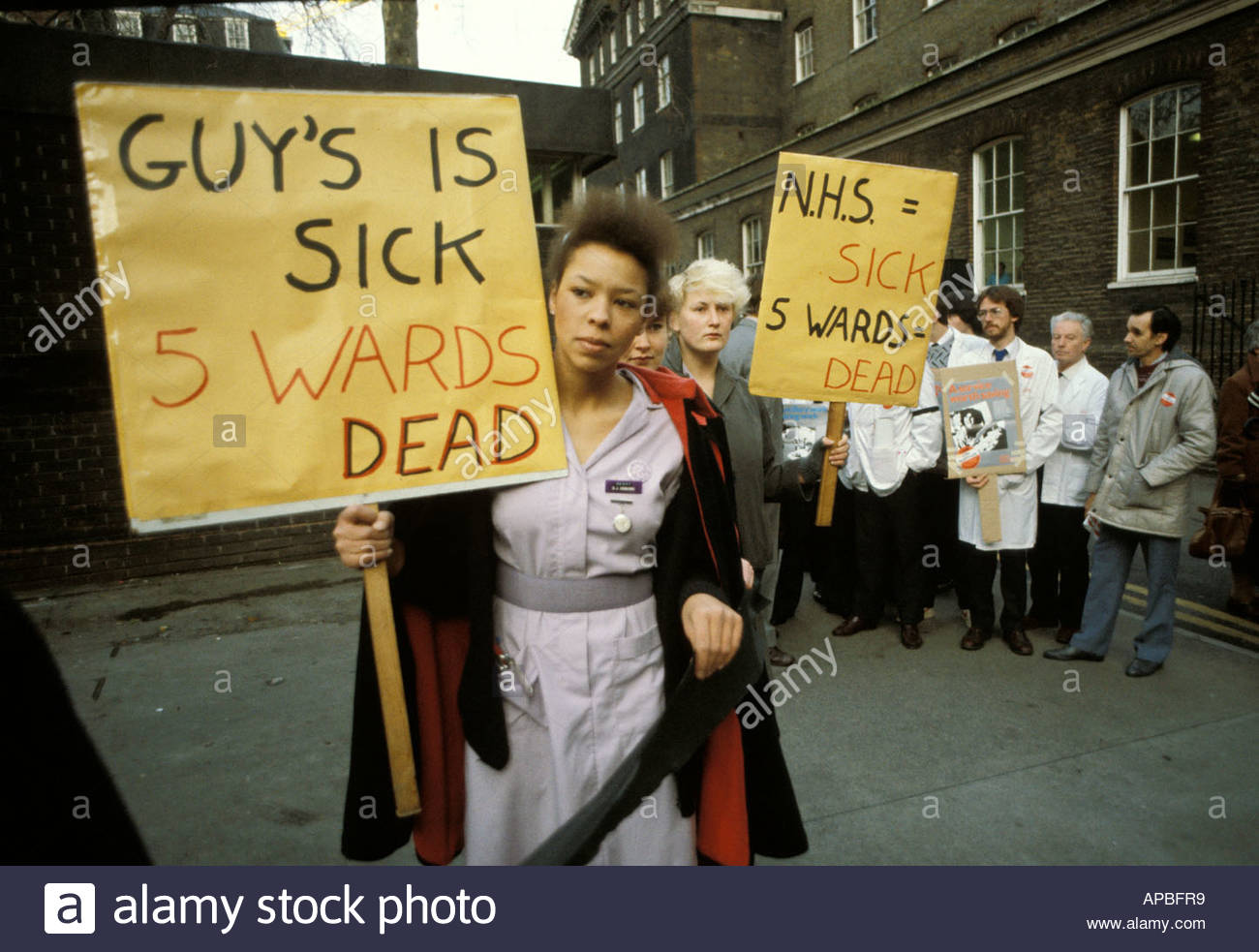 Nurses protest outside Guys Hospital at cuts in NHS funding and ward closures, London 1984 - Stock Image