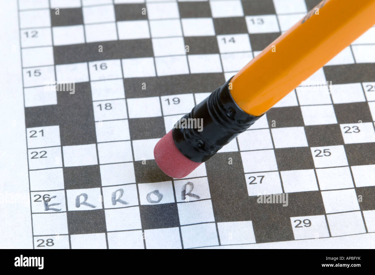 Error written on a crossword and about to be erased - Stock Image