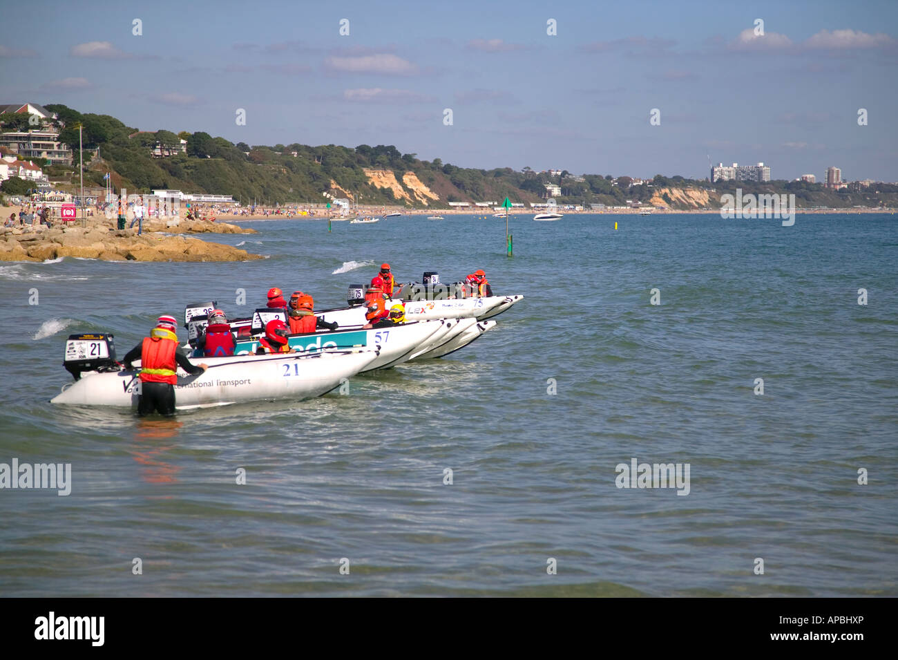 Powerboat racing at Sandbanks near Poole Dorset England Bournemouth in the distance - Stock Image