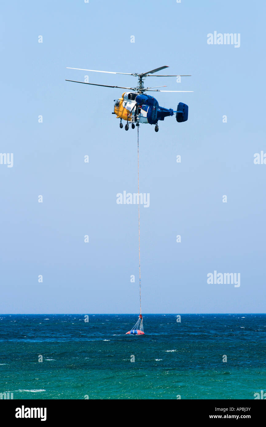 Firefighting Helicopter near Chania, North West Coast, Crete, Greece - Stock Image