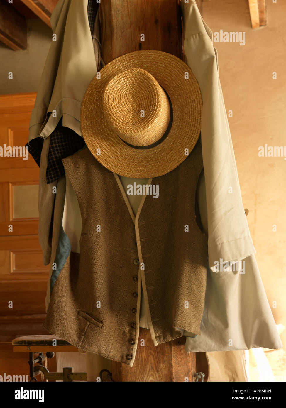 b58a3110a10 Canada Ontario Morrisburg Upper Canada Village antique straw hat and vest  hanging on a wooden post