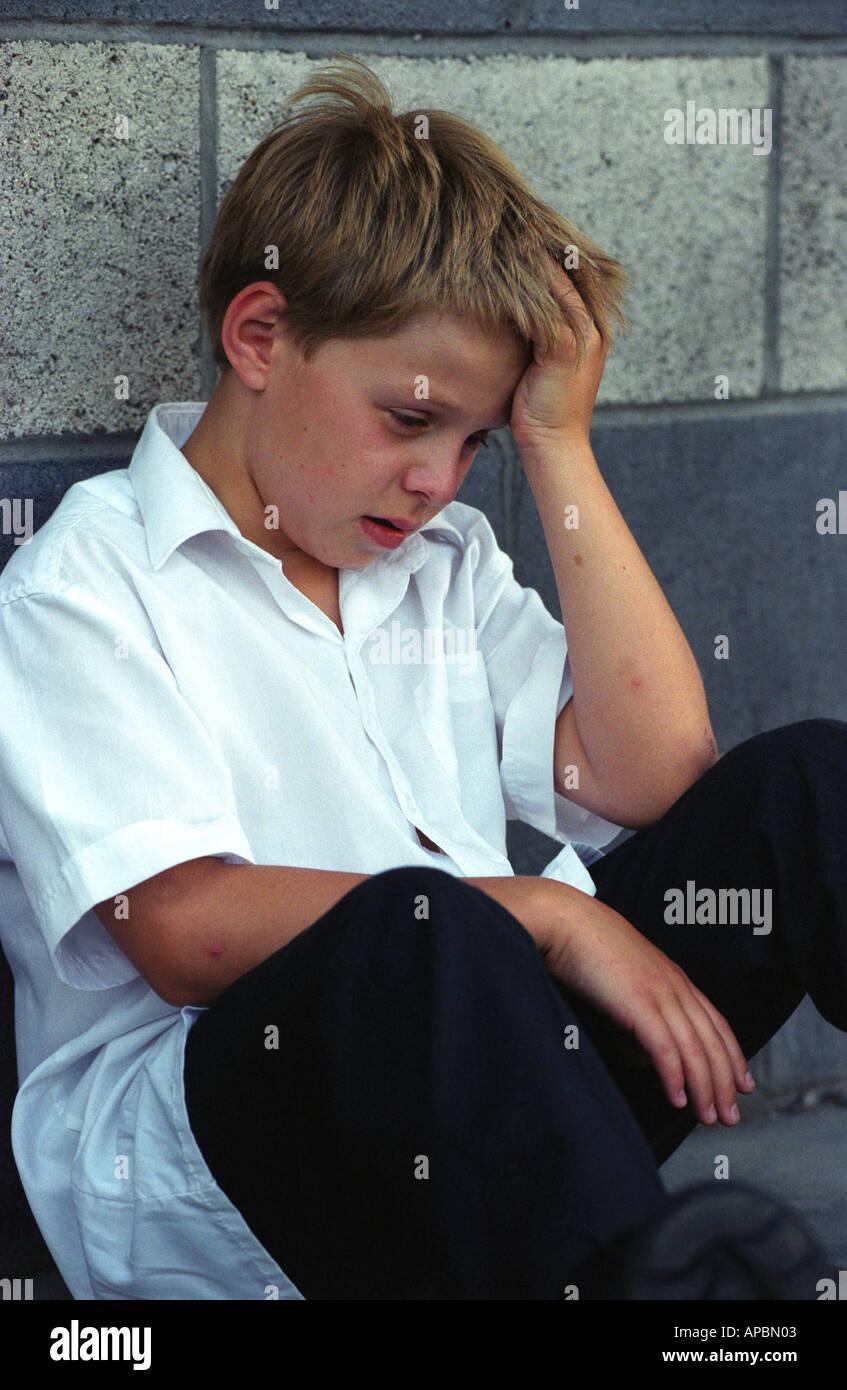 8 Year Boy Bedroom Design: Boy Sitting Head Down Sad Stock Photos & Boy Sitting Head