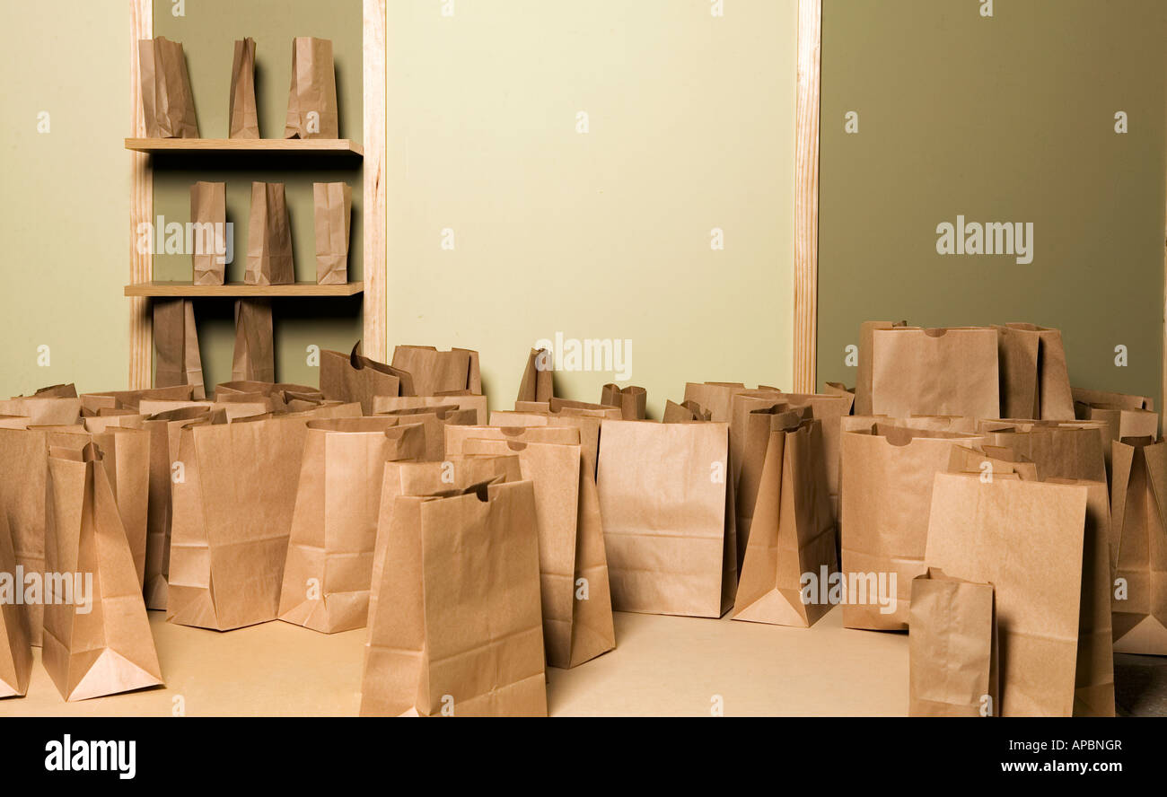 many paper bags in room empty recycle waste green extra - Stock Image